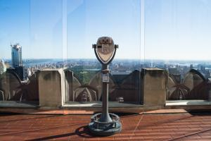 binoculars on rockefeller center c with the city of New York from the top